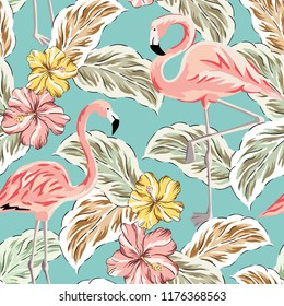Tropical pink flamingo birds, yellow hibiscus flowers bouquets, palm leaves background. Vector seamless pattern. Jungle illustration. Exotic plants. Summer beach floral design. Paradise nature