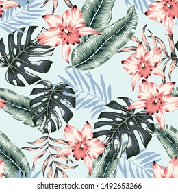 Tropical pink orchid flowers, monstera, banana palm leaves, light blue background. Vector seamless pattern. Jungle foliage illustration. Exotic plants. Summer beach floral design. Paradise nature