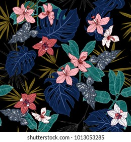 Tropical plants, flowers and leaves seamless pattern on a black background. Vector illustration.