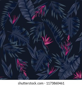 Tropical plants leaves and flowers of the bird of paradise. Seamless beach pattern on black background wallpaper