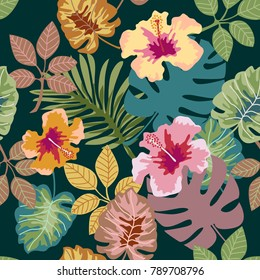 Tropical plants on dark green background. Seamless botanical pattern with aloha motifs. Trendy design for textile, cards and invitations.