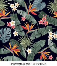 Tropical seamless pattern with palm leaves and exotic flowers. Vector illustration.