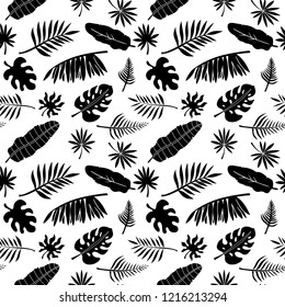 Tropical seamless pattern. Palm leaves, branches. Natural background texture. Summer print. Fabric design in black and white