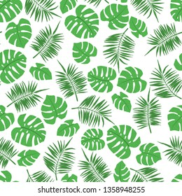 Tropical seamless pattern with palm and monstera leaves. Design element for fabric, textile, wallpaper, scrapbooking or others. Vector illustration.