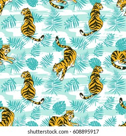 Tropical seamless pattern with tigers and palm leaves. Vector animalistic design for fabric, wrap paper or wallpaper. Exotic art background.