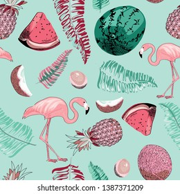 Tropical seamless pattern. Vector illustration of the flamingos, lemons, coconuts, melons and tropical leaves on light blue background