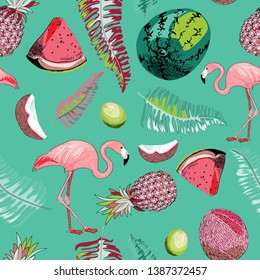 Tropical seamless pattern. Vector illustration of flamingos, lemons, melons, coconut and tropical leaves on turquoise background