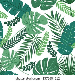 Tropical seamless repeat pattern with green leaves of different shapes overlapping