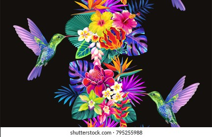 Tropical seamless vertical border with palm leaves, exotic flowers and hummingbirds on a black background. Vector illustration.