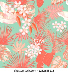 Tropical vector seamless pattern in Living Coral color. Main trend concept. Botany design, jungle leaves of palm tree and flowers.