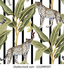 Tropical vintage banana trees and leopard floral seamless pattern black and white striped background. Exotic jungle wallpaper.