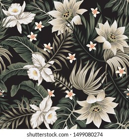 Tropical vintage night white orchid, lotus flower, palm leaves floral seamless pattern black background. Exotic jungle wallpaper.