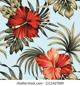 Tropical vintage red hibiscus floral green palm leaves seamless pattern blue background. Exotic Hawaiian wallpaper.