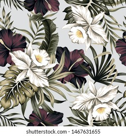 Tropical vintage white orchid, purple hibiscus flower, palm leaves floral seamless pattern grey background. Exotic jungle wallpaper.