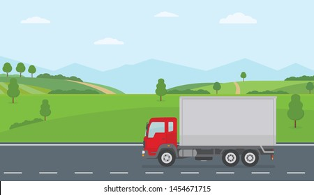 Truck moving on asphalt road along the green fields in rural landscape. Transport services concept. Flat style vector illustration.