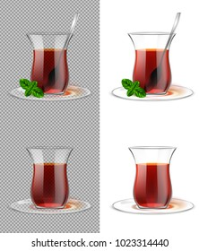 Turkish tea cup with black tea, silver spoon and mint. Armudu glass