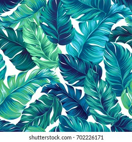 turquoise and green tropical leaves. Seamless graphic design with amazing palms. Fashion, interior, wrapping, packaging suitable. Realistic palm leaves.