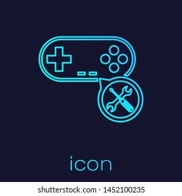 Turquoise line Gamepad with screwdriver and wrench icon isolated on blue background. Adjusting, service, setting, maintenance, repair, fixing.  Vector Illustration