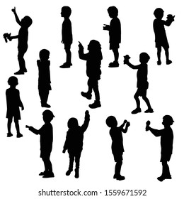 Twelve silhouette of a child that plays; vector illustration