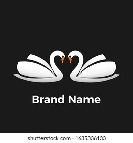 Twin Swan Logo. logo illustration is a twin goose that forms a heart.