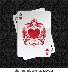 two aces playing cards on black seamless damask pattern(hearts overlies)