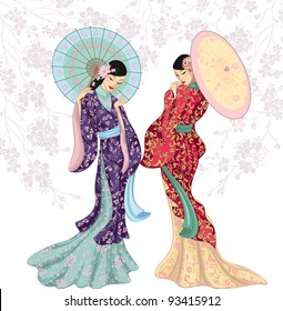 Two beautiful Chinese women with umbrellas isolated over white