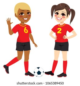 Two beautiful diverse soccer player teenager girls with black and red uniform