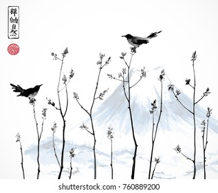 Two black birds, young trees branches and Fujiyama mountain. Traditional Japanese ink painting sumi-e. Contains hieroglyphs - zen, freedom, nature