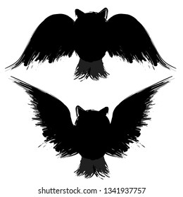 Two black grunge owl silhouettes isolated on white background