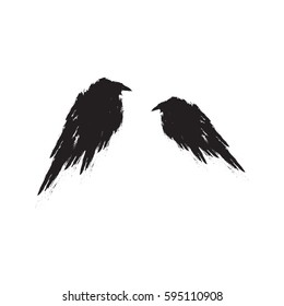 Two black ravens isolated on a white background.