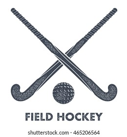 Two black silhouettes sticks for field hockey and ball on a white background with grunge texture. Vector illustration.