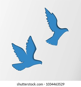 Two blue flying paper pigeons cutting from the paper, vector.