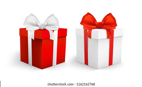 two boxes with gifts stand isolated on white background