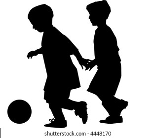 Two boys playing soccer silhouettes