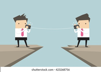 Two businessman talking with tin can on cliff vector