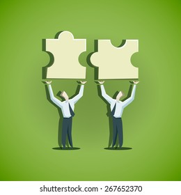 Two businessman trying to combine puzzle pieces