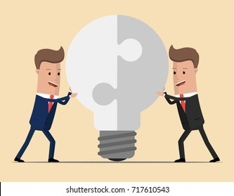 Two businessmen unite lamp of the puzzle. Joining forces, the birth of a new idea