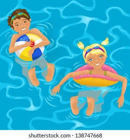 Two cheerful kids swimming in the pool or in the ocean