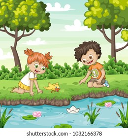 Two children play with a boat by al lake