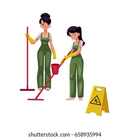 Two cleaning service girls, charwomen in overalls using mops and bucket, wet floor sign, cartoon vector illustration isolated on white background. Cleaning service girls in uniforms washing floor