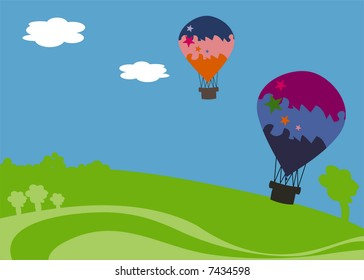 Two colorful balloons over a green hill