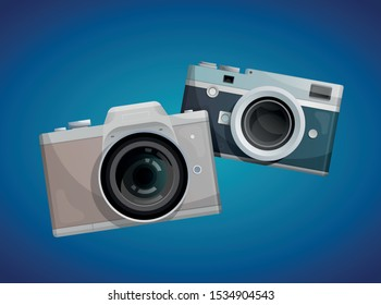 Two compact cameras on blue background