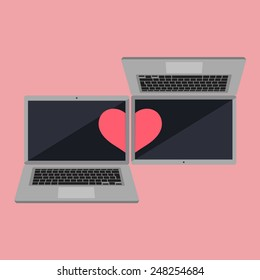 Two computers connected by heart, referring to long distance love/relationship or on-line dating in form of valentine card