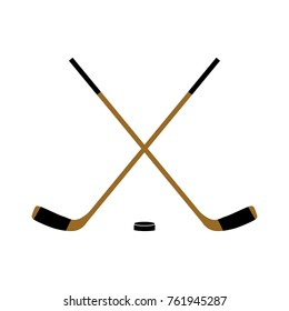 Two crossed hockey sticks and a washer. Isolated on white background. Vector illustration