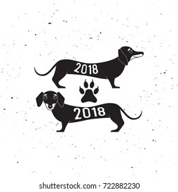Two cute dachshund dogs, silhouette, logo, Happy new year of the dog 2018 vector illustration
