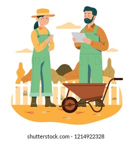 Two farmer using technology and smartphone for their farm, modern and high tech farmer and agriculture concept