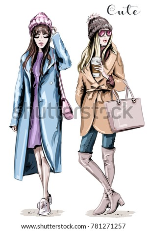 19d133ecf8 Two fashion women. Hand drawn stylish beautiful women in winter clothes. Fashion  winter outfits. Sketch. - Vector