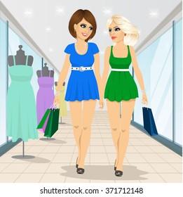 two fashion women walking in shopping mall