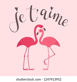 """Two flamingos in love with modern calligraphy inscription in French """"je t'aime"""". Romantic Valentine's Day greeting card template"""