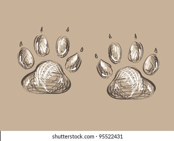 Two free hand drawing paws print on beige background, original design